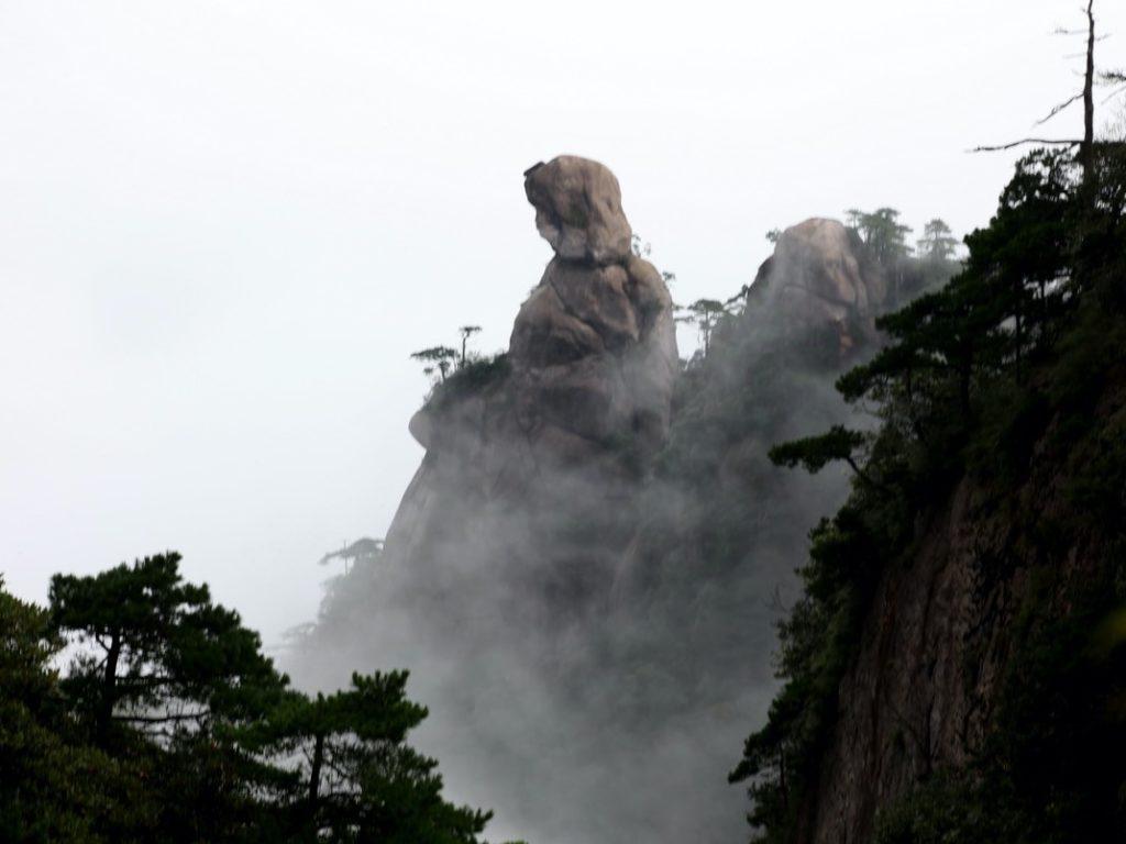 Light clouds float around the Goddess Peak